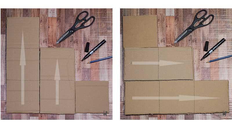 Die erste Lage der Pappstreifen liegt vertikal, die Zweite wird horizontal darüber geklebt (siehe Pfeile)